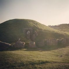 Working on a large production list today and dreaming of being here!  Bryn Celli Ddu burial chamber at sunset.  #sunset #sun #ruins #nature #pretty #beautiful #red #orange #history #burialchamber  #sky #skyporn #cloudporn #nature #clouds #horizon #photoof