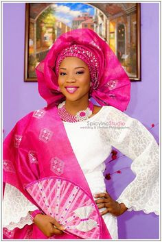Fuchsia Pink Gele, Ipele, beads, lips and eyes. What's not to love. Photo taken by Spicy INC studios at a Yoruba engagement Ceremony