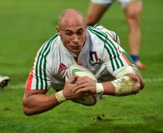Italy No.8 Sergio Parisse dives to score a try