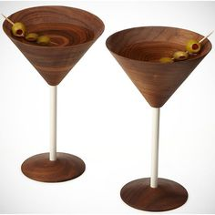 Colorado-based furniture designer David Rasmussen recently turned his attention to making these really cool martini glasses that sport black walnut wood cups instead of the usual glass ones. It's not just pretty but functional: using wood properly insulates the drink by keeping it cool for a longer time compared to glass.