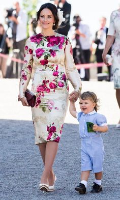 The Swedish royals were all about summer florals at Princess Adrienne's Drottningholm Palace Chapel christening. Here, the baby's aunt Princess Sofia wears a beautiful blossom print as she holds son Prince Alexander's hand.
