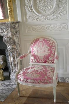 This is one of the chairs in the Petit Trianon (Versailles) that was made for Marie Antoinette.  Although the fabric appears pink in this picture, it's actually more of a red hue.