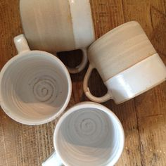 Mugs by me - light stoneware clay with Lucie Rie white half glaze.