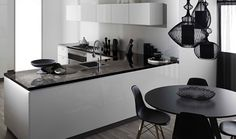 Benchtop Laminex 180fx Black Fossilstone DiamondGloss finish. Upper cupboards and drawers Laminex CrystalGloss Polar White. Cabinetry Laminex CrystalGloss Polar White. Splashback Laminex Metaline Palladian Perle. Styling Suki Ibbetson. Photography Earl Carter.