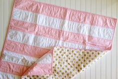 Pink Gold Stripe Baby Quilt ... need to make something like this. Love! Wonder where I buy that gold polka dot fabric!?!