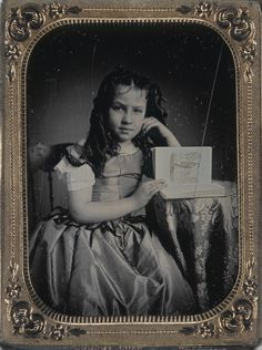 Girl with a book that is apparently about Benjamin Franklin. Image by Thomas M. Easterly