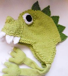 crochet dinosaur patterns Adorably cute Dinosaur/Dragon knitted hat pattern with the unique addition of adorably cute paws with claws for ties, also instructions for braided t Knitted Mittens Pattern, Animal Knitting Patterns, Knitted Hats, Crochet Patterns, Dinosaur Hat, Crochet Dinosaur, Dinosaur Pattern, Knitting For Kids, Knitting Projects
