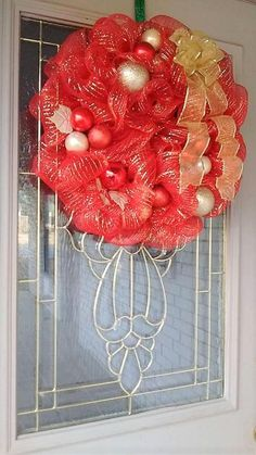 A big, ruffly, red and gold Christmas wreath. Its'bright colors will surely make your holiday display stand out. Perfect size for your front door and it's sparkle is very eye catching. I made this with 9 yards of red and gold deco mesh, glittery shatter proof ornaments, a handmade wire rimmed bow and gold leaves. Item is 20 inches.