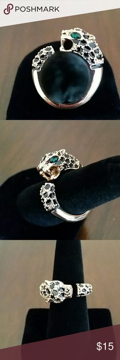 Fancy Animal Wrap Ring- Cheetah Fancy Animal Wrap Ring- Cheetah. Gorgeous goldtone band with black spots & stunning green eyes. Avon Jewelry Rings