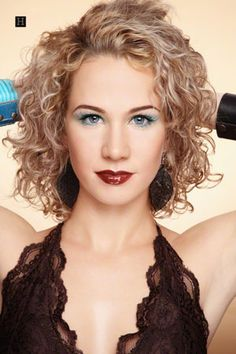 woman with medium length layered spiral perm curly hairstyles blonde hair... really like the style but with brown hair re