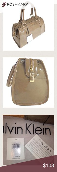 New! Calvin Klein Patent Leather Taupe Satchel New! Shiny taupe patent leather Calvin Klein satchel. Double handles with zip top closure. Two exterior side pockets. Interior has two slip pockets and one zip pocket. Gold hardware.  Tags removed but are inside bag and dust bag is included. Calvin Klein Bags Satchels