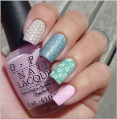 Pastel nails - tan with white dots, blue glitter, light green with white roses stamp and pale pink