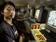 People Around the World Pose With Everything They Eat in a Day | Xu Zhipeng, a freelance computer graphics artist and Internet gamer, with his typical day's worth of food in his rented chair at the Ming Wang Internet Café in Shanghai, China. The caloric value of his day's worth of food in June was 1600 kcals. He is 23 years of age