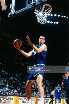 Bruno Sundov #40 of the Dallas Mavericks grabs a rebound against the Golden State Warriors circa 2000 at Oracle Arena in Oakland, CA.