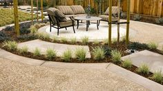 exposed aggregate with concrete banding and pads create an inviting seating alcove in this Alamo Creek backyard (Shapell Homes)