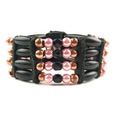 This bold bracelet was made by Chippewa artist Lynn LaRocque and features horn hairpipe and faceted beads.Fashioned after the traditional horn chokers of the past, this contemporary bracelet bo...