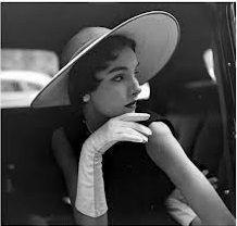 A lady wears gloves