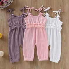 The Joy Romper cotton linen romper for baby girl.  Lightweight material perfect for summer and soft on babies skin.