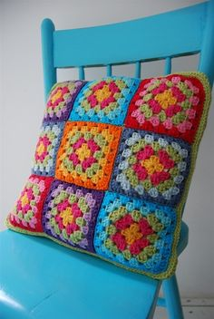 Granny square. I like how the painted chair and some of the yarn in the pillow match so closely.