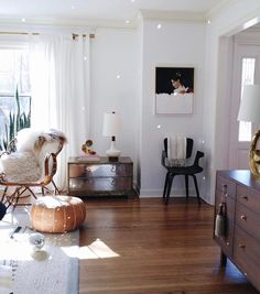 Drop a disco ball in the sunlight for a sparly room - mid century modern home decor with an eclectic mix - via House Of Hipsters
