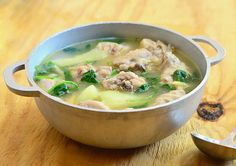 Tinolang Manok (Chicken Tinola) is a Filipino chicken soup made with chicken pieces, papaya, spinach and ginger-based broth