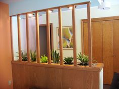 An entryway with built-in planters.  My entry isn't big enough, but I want one for the built in buffet area.