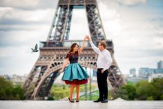 Couple dancing in front of Eiffel Tower