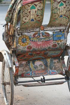 Rickshaw art in Dhaka. Rickshaws are icons in Dhaka and are wildly popular amongst students and businessmen alike. They are often beautiful displays of artwork, with images of their driver's favorite Bollywood actors, cricket players, flowers, designs etc.