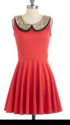 coral dress with a black n gold studded collar