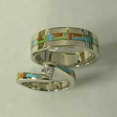 Mens and Ladies 14 Karat White Gold Wedding Set with Multi Color Inlay and Diamond.