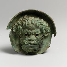 Silvered bronze roundel with satyr head (one of a pair) | Greek | Hellenistic, ca. 325–300 B.C. | The Met