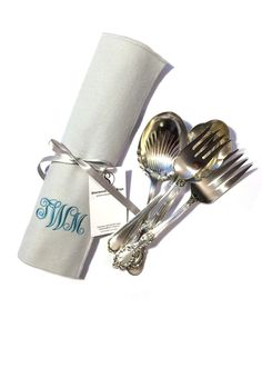 Protecting silver serving pieces is easy and beautiful with an anti-tarnish flatware roll by Sherwood Silver Bags.