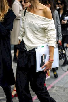 Le Fashion Blog Fall Street Style Pfw Ivory Cable Off The Shoulder Sweater Jacket Tied Around Waist Black Slouchy Pants Via Vogue Mexico