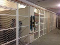 cage fitted in a store room in a commercial building in London. Metal Fabrication, Cage, Commercial, London, Storage, Building, Room, Wine Cellars, Masks