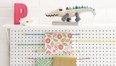 Turn super-stretchy bungee cords into a magazine rack. -- Lowe's Creative Ideas