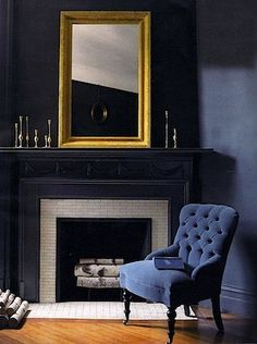 Dark blue walls and mantle, high contrast with white bricks and tile on the fireplace
