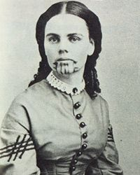 Olive Oatman was taken captive by the Yavapai in 1851, when she was fourteen, and sold a year or so later to the Mohave, who adopted her and tattooed her face.  She was ransomed after about five years and became something of a celebrity, eventually marrying and settling in Texas.