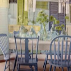 Awesome idea. Painted different wooden chairs for the kitchen.