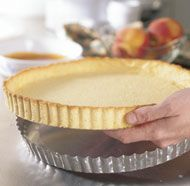 This cookie-like crust is perfect for custard or fresh fruit fillings that don't need further cooking, such as this combination of