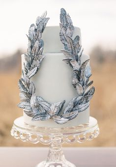 white wedding cake with silver leafs