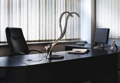 Table lamp made out of steel and technopolymers, featuring two separate adjustable arms. The light is conveyed through silicium fiber optics. #RA by #Lumina