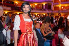 With hair platted and wearing a traditional Austrian clothing, Conchita Pictured is pictur...