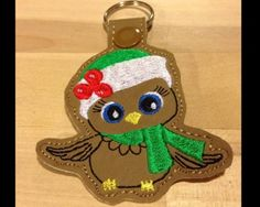 Christmas Owl Key Fob  This Adorable Key Fob sews in the 4x4 hoop on brown colored vinyl.  This item is perfect for use as a zipper pull, a backpack charm or a key fob!!  Available Formats Include - DST, PES, PEC, HUS, JEF, VIP, VP3, and EXP  You may make this design as many times as you like, and you may sell your finished key fobs, however, please do not modify, share or resell my original digital design.  Thanks so much and happy stitching!!
