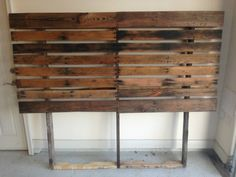 LED bed headboard made out of pallets.