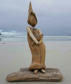 Lady with a fish #driftwood #art #norway