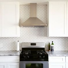 small scale white hexagon tiles with black grout stand out and make the backspla. small scale white hexagon tiles with black grout stand out and make the backsplash eye catchy Black And White Backsplash, White Kitchen Backsplash, Kitchen Tiles, Black Grout, Diy Kitchen, Kitchen Cupboard, Hexagon Tile Backsplash, Backsplash Design, Backsplash Ideas