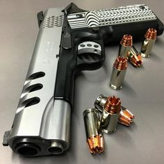 Smith & Wesson 1911 Performance Center .45acp with VZ grips and Tru Dot sights.