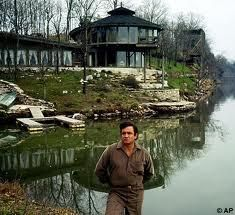 Johnny Cash in front of the lake house in Hendersonville, TN