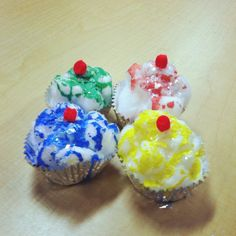 """Cupcake craft for Laura Numeroff's """"If You Give a Cat a Cupcake"""" book. [Foil cupcake liners, cotton balls, glue and powder paint, fake glitter snow and pompom]"""