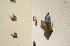 Miniature figures on tiny caged balconies just want someone to talk to. Concept, Art, Technology, Sculpture, Loneliness, Disconnect